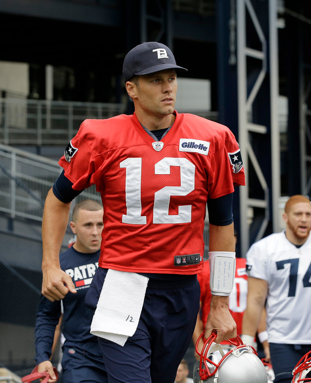 . New England Patriots quarterback Tom Brady (12) steps on the field at NFL football training camp, Thursday, July 27, 2017, in Foxborough, Mass. (AP Photo/Steven Senne)