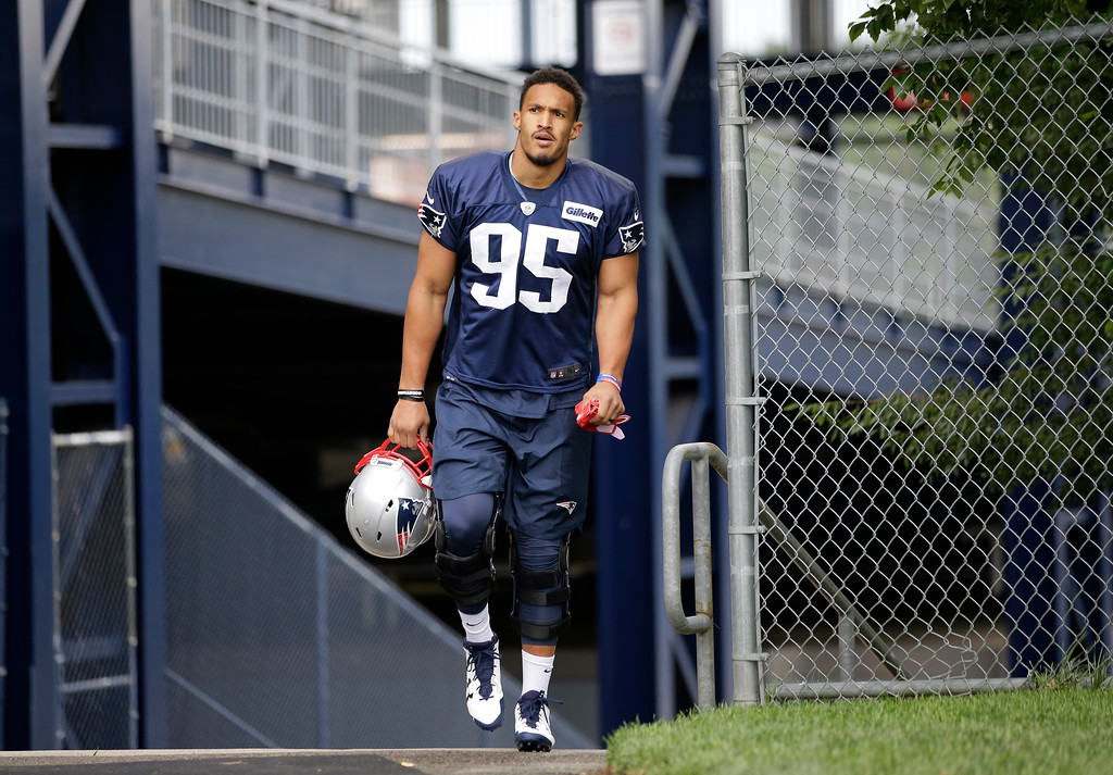 . New England Patriots defensive end Derek Rivers (95) steps on the field at NFL football training camp, Thursday, July 27, 2017, in Foxborough, Mass. (AP Photo/Steven Senne)