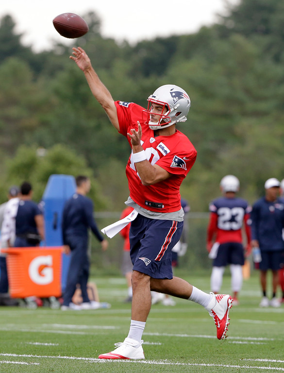 . New England Patriots quarterback Jimmy Garoppolo throws a pass during NFL football training camp, Thursday, July 27, 2017, in Foxborough, Mass. (AP Photo/Steven Senne)
