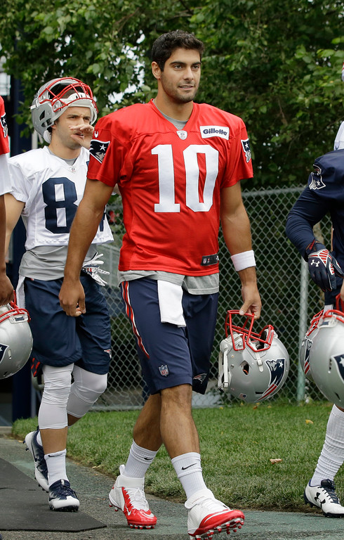 . New England Patriots quarterback Jimmy Garoppolo (10) steps on the field at NFL football training camp, Thursday, July 27, 2017, in Foxborough, Mass. (AP Photo/Steven Senne)