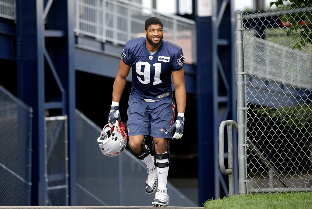 . New England Patriots defensive end Deatrich Wise (91) steps on the field at NFL football training camp, Thursday, July 27, 2017, in Foxborough, Mass. (AP Photo/Steven Senne)