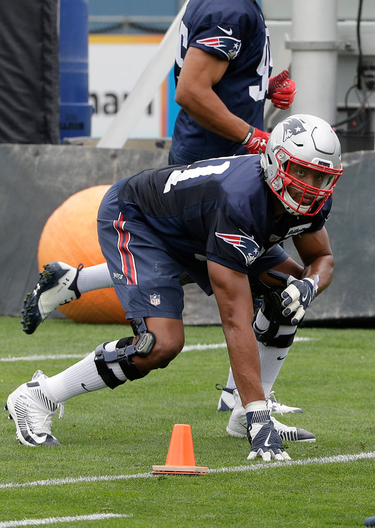 . New England Patriots defensive end Deatrich Wise (91) performs field drills at NFL football training camp, Thursday, July 27, 2017, in Foxborough, Mass. (AP Photo/Steven Senne)