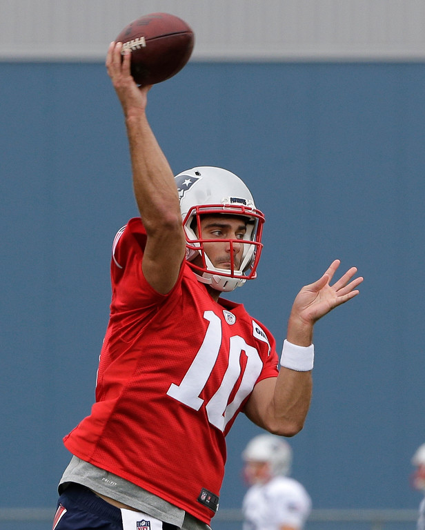 . New England Patriots quarterback Jimmy Garoppolo (10) passes the ball at NFL football training camp, Thursday, July 27, 2017, in Foxborough, Mass. (AP Photo/Steven Senne)