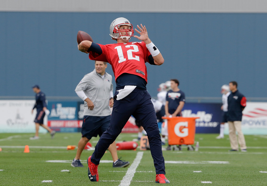 . New England Patriots quarterback Tom Brady passes the ball at NFL football training camp, Thursday, July 27, 2017, in Foxborough, Mass. (AP Photo/Steven Senne)