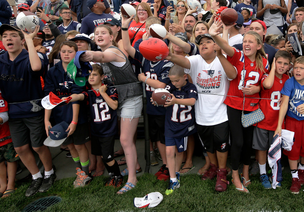 . Fans call out for autographs from members of the New England Patriots as the players prepare to leave the field at NFL football training camp, Thursday, July 27, 2017, in Foxborough, Mass. (AP Photo/Steven Senne)