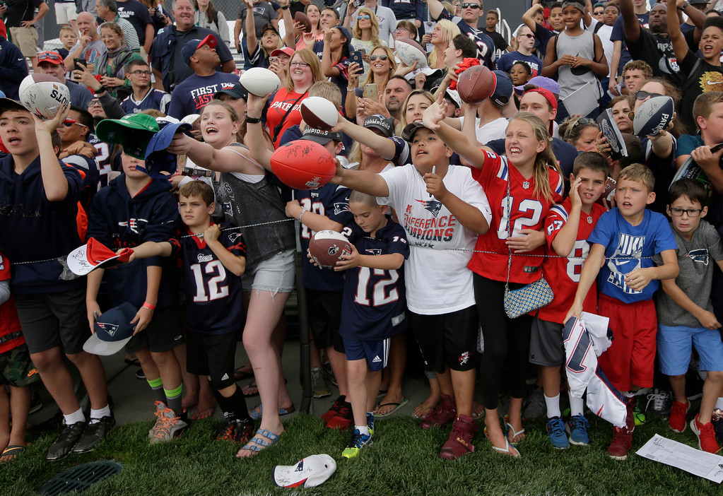 . Fans call out to members of the New England Patriots as the players prepare to leave the field at NFL football training camp, Thursday, July 27, 2017, in Foxborough, Mass. (AP Photo/Steven Senne)