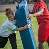 A participant in the New England Patriots Alumni Football For You program hits a tackling dummy at Crocker Field. SENTINEL&ENTERPRISE/ Jim Marabello
