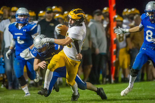 Panther running back Austin Mersch (20) breaks several tackles and runs in a touchdown for Pioneer in the second quarter in their 55-21 victory over Carroll on Friday night. Fran Ruchalski | Pharos-Tribune