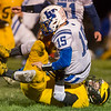 Panthers linebacker Danny Gregorich (24) brings down Lancers quarterback Braxton Sauer (15) in the backfield in the first quarter. Pioneer defeated LaVille 38-0 in regional football action at the Pit on Friday night. Fran Ruchalski | Pharos-Tribune