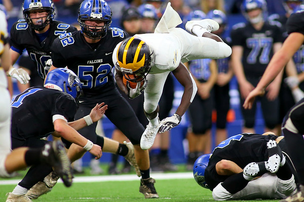 Pioneer's Ezra Lewellen jumps over the line as they beat North Vermillion in the Class A State Finals 60-0 on Nov. 24, 2018 at Lucas Oil Stadium.<br /> Tim Bath | Kokomo Tribune