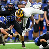 Pioneer's Ezra Lewellen jumps over the line as they beat North Vermillion in the Class A State Finals 60-0 on Nov. 24, 2018 at Lucas Oil Stadium.<br /> Tim Bath   Kokomo Tribune