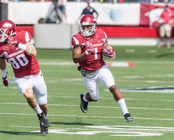 Jared Cornelius runs behind the blocking of Drew Morgan during a football game between the Arkansas Razorbacks and the Alcorn State Braves on Saturday, October 1, 2016.  (Alan Jamison, Nate Allen Sports Service)