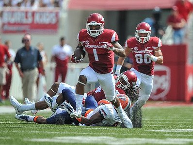 Arkansas Razorbacks wide receiver Jared Cornelius (1) takes off for a touchdown during a football game between the Arkansas Razorbacks and the UTEP Miners on Saturday, September 5, 2015 at the  Donald W. Reynolds Razorback Stadium in Fayetteville, Arkansas.  Arkansas won the game 48-13.  (Alan Jamison, Nate Allen Sports Service).
