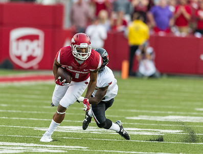 Arkansas wide receiver Jared Cornelius (1) runs after a catch during a football game between the Arkansas Razorbacks and the Texas Tech Red Raiders at Reynolds Razorback Stadium at the University of Arkansas in Fayetteville, Arkansas.   Texas Tech won 35-24.  (Alan Jamison, Nate Allen Sports Service)