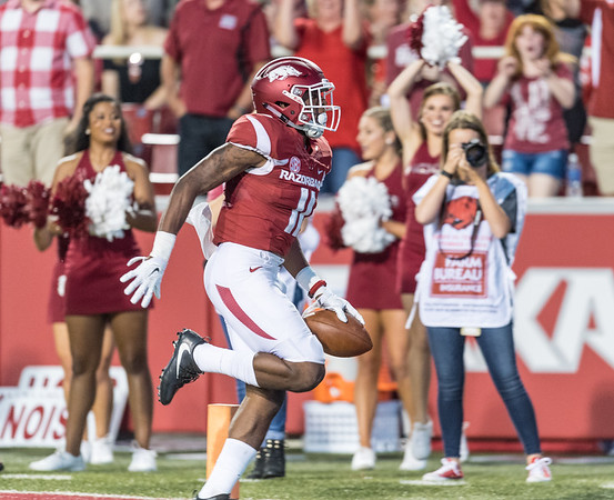 Arkansas Razorbacks defensive back Ryan Pulley (11) with a pick six during a football game between the Arkansas Razorbacks and the Texas State Bobcats on Saturday, September 17, 2016.  (Alan Jamison, Nate Allen Sports Service)