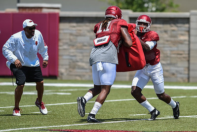 Tight end Will Gragg (11) with wide receiver Damon Mitchell (7) at Razorback Football practice on Saturday, August 8, 2015 at the Fred W. Smith Football Center in Fayetteville, Arkansas.   (Alan Jamison, Nate Allen Sports Service).