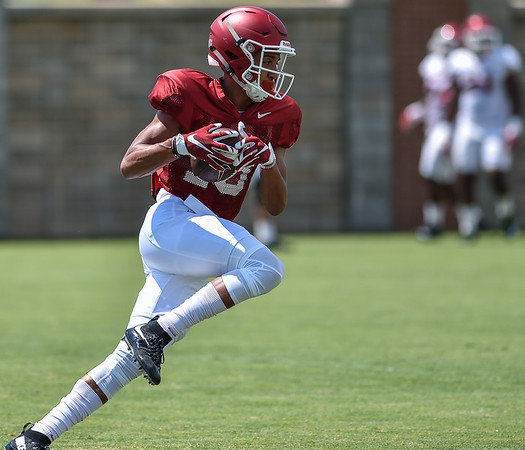Wide receiver Deon Stewart (13) at Razorback Football practice on Saturday, August 8, 2015 at the Fred W. Smith Football Center in Fayetteville, Arkansas.   (Alan Jamison, Nate Allen Sports Service).