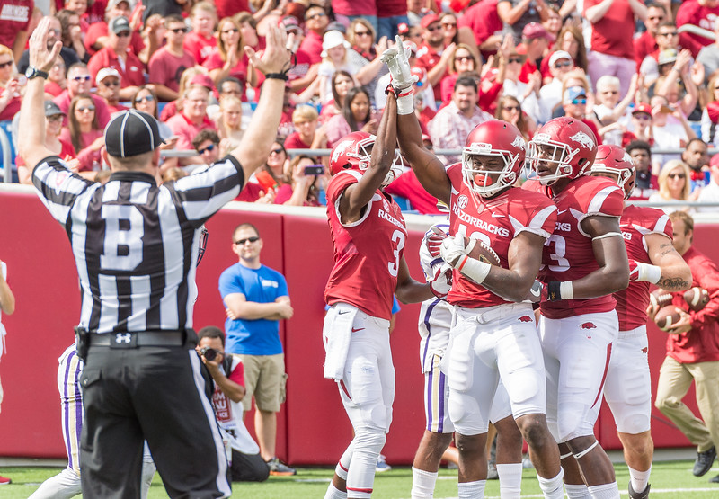 Arkansas Razorbacks wide receiver La'Michael Pettway (16) celebrates a rushing touchdown during a football game between the Arkansas Razorbacks and the Alcorn State Braves on Saturday, October 1, 2016.  (Alan Jamison, Nate Allen Sports Service)