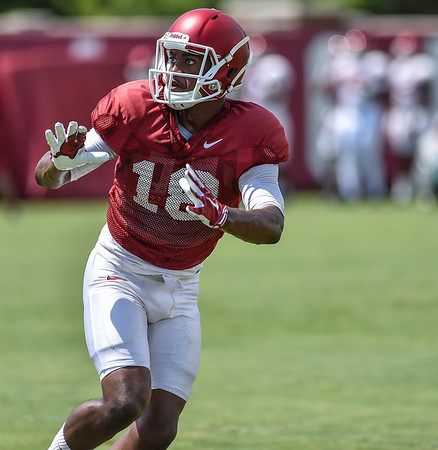 Wide receiver Cameron Colbert (18) at Razorback Football practice on Saturday, August 8, 2015 at the Fred W. Smith Football Center in Fayetteville, Arkansas.   (Alan Jamison, Nate Allen Sports Service).