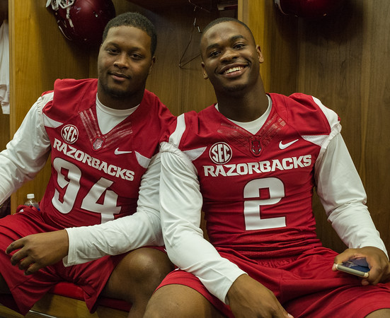 Taiwan Johnson (94) and DJ Dean (2) at the Razorback Media Day on Sunday, August 9, 2015 at the Fred W. Smith Football Center in Fayetteville, Arkansas.   (Alan Jamison, Nate Allen Sports Service).