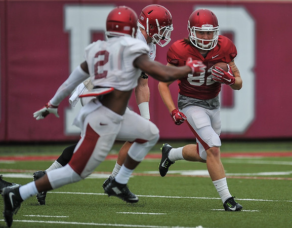 Brooks Ellis and DJ Dean pursue Luke Rossi at the Razorback football practice on Tuesday, August 18, 2015 at the Fred W. Smith Football Center in Fayetteville, Arkansas.   (Alan Jamison, Nate Allen Sports Service).