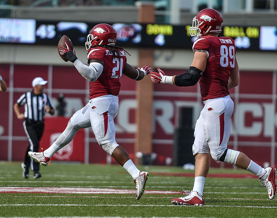 Arkansas Razorbacks linebacker Josh Williams (21) celebrates his recovery of a UTEP fumble on a punt return during a football game between the Arkansas Razorbacks and the UTEP Miners on Saturday, September 5, 2015 at the  Donald W. Reynolds Razorback Stadium in Fayetteville, Arkansas.  Arkansas won the game 48-13.  (Alan Jamison, Nate Allen Sports Service).