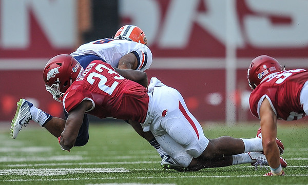 Arkansas Razorbacks linebacker Dre Greenlaw (23) with a tackle during a football game between the Arkansas Razorbacks and the UTEP Miners on Saturday, September 5, 2015 at the  Donald W. Reynolds Razorback Stadium in Fayetteville, Arkansas.  Arkansas won the game 48-13.  (Alan Jamison, Nate Allen Sports Service).