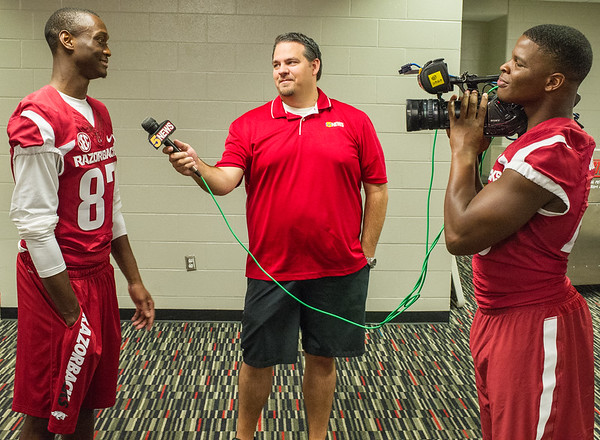 Dominique Reed being interviewed by teammate Dre Greenlaw and 5News Bobby Swofford at Razorback Media Day on Sunday, August 9, 2015 at the Fred W. Smith Football Center in Fayetteville, Arkansas.   (Alan Jamison, Nate Allen Sports Service).