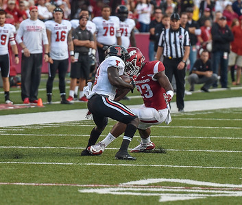 Arkansas linebacker Dre Greenlaw (23) with a tackle during a football game between the Arkansas Razorbacks and the Texas Tech Red Raiders at Reynolds Razorback Stadium at the University of Arkansas in Fayetteville, Arkansas.   Texas Tech won 35-24.  (Alan Jamison, Nate Allen Sports Service)
