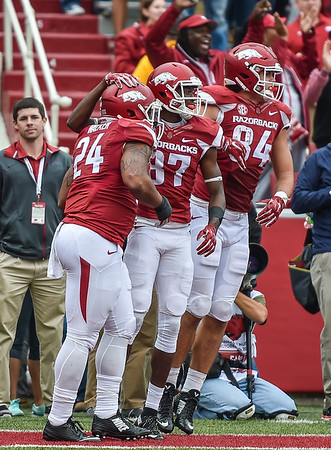 Arkansas Razorbacks wide receiver Dominique Reed (87) and Arkansas Razorbacks tight end Hunter Henry (84) celebrate with Arkansas Razorbacks running back Kody Walker (24) after Walker's two point conversion in overtime during the football game between the Arkansas Razorbacks and the Auburn Tigers at Reynolds Razorback Stadium in Fayetteville, Arkansas.  Arkansas won 54-46 in four overtimes.  (Alan Jamison, Nate Allen Sports Service)