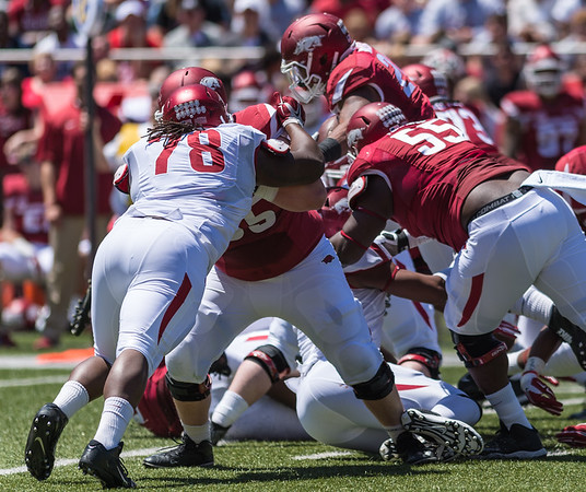 Defensive Tackle Bijhon Jackson attempts to tackle Junior Running Back Kody Walker during the Arkansas Red-White Spring Football Game on Saturday, April 25, 2015 in Fayetteville, Arkansas at Donald W. Reynolds Razorback Stadium.  The Red team won 62-18 in front of an official attendance of 41,220 fans.   (Alan Jamison, Nate Allen Sports Service)