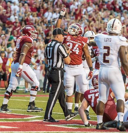 Arkansas Razorbacks running back Kody Walker (24) celebrates a touchdown run during a football game between the Arkansas Razorbacks and the Texas State Bobcats on Saturday, September 17, 2016.  (Alan Jamison, Nate Allen Sports Service)