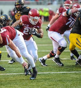 Arkansas Razorbacks running back Kody Walker (24) with a touchdown run during a football game between Arkansas and Missouri on November 27, 2015.    (Alan Jamison, Nate Allen Sports Service)