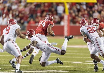 Arkansas Razorbacks running back Kody Walker (24) rushes during a football game between Arkansas and Alabama on Saturday, October 8, 2016.  (Alan Jamison, Nate Allen Sports Service)