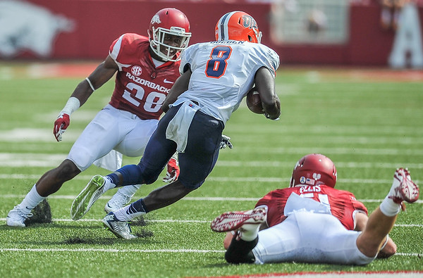 Josh Liddell prepares to tackle UTEP wide receiver Autrey Golden during a football game between the Arkansas Razorbacks and the UTEP Miners on Saturday, September 5, 2015 at the  Donald W. Reynolds Razorback Stadium in Fayetteville, Arkansas.  Arkansas won the game 48-13.  (Alan Jamison, Nate Allen Sports Service).