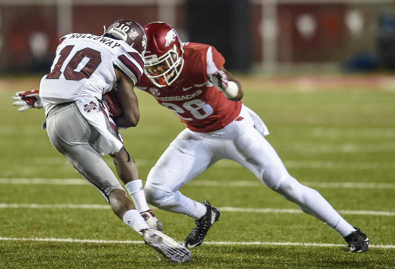 Arkansas Razorbacks defensive back Josh Liddell (28) with a tackle during a football game between Arkansas and Mississippi State on November 21, 2015.    (Alan Jamison, Nate Allen Sports Service)