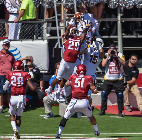 Jared Collins breaks up a pass attempt during a football game between the Arkansas Razorbacks and the Toledo Rockets on Saturday, 9/12/2015.  Toledo won 16-12.   (Alan Jamison, Nate Allen Sports Service)