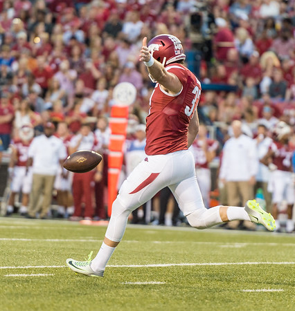 Arkansas Razorbacks punter Toby Baker (37) punts during a football game between the Arkansas Razorbacks and the Texas State Bobcats on Saturday, September 17, 2016.  (Alan Jamison, Nate Allen Sports Service)