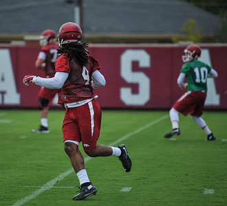 Keon Hatcher and Brandon Allen during the first  Fall Razorback Football practice on Thursday, August 6, 2015 at the Fred W. Smith Football Center in Fayetteville, Arkansas.   Photos by Alan Jamison.