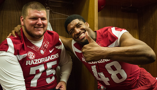 Zach Rogers (75) and Deatrich Wise, Jr. at the Razorback Media Day on Sunday, August 9, 2015 at the Fred W. Smith Football Center in Fayetteville, Arkansas.   (Alan Jamison, Nate Allen Sports Service).