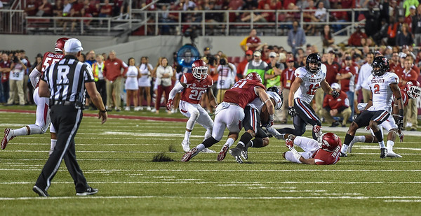 Linebacker Brooks Ellis (51) with a tackle during a football game between the Arkansas Razorbacks and the Texas Tech Red Raiders at Reynolds Razorback Stadium at the University of Arkansas in Fayetteville, Arkansas.   Texas Tech won 35-24.  (Alan Jamison, Nate Allen Sports Service)