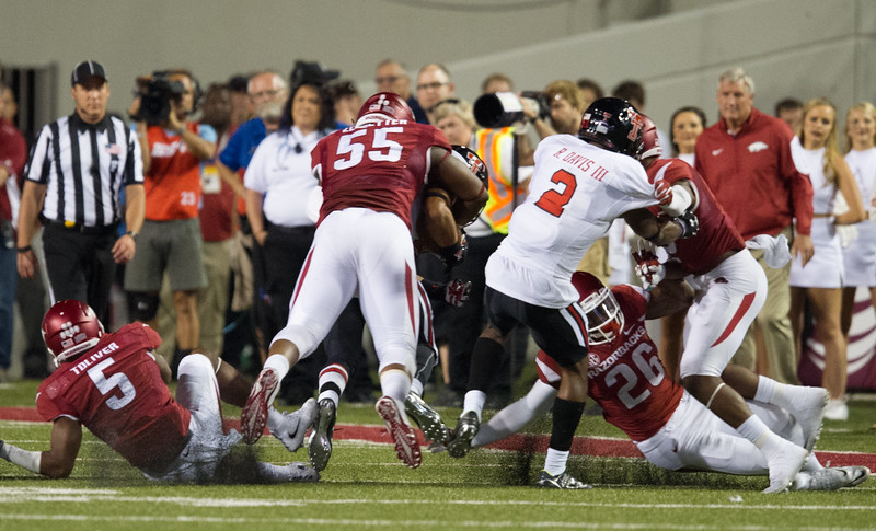 Jeremiah Ledbetter (55) with a tackle during a football game between the Arkansas Razorbacks and the Texas Tech Red Raiders at Reynolds Razorback Stadium at the University of Arkansas in Fayetteville, Arkansas.   Texas Tech won 35-24.  (Alan Jamison, Nate Allen Sports Service)