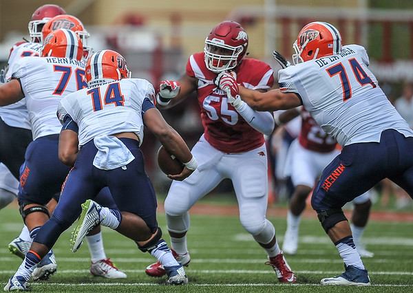 Jeremiah Ledbetter prepares to tackle UTEP quarterback Kavika Johnson during a football game between the Arkansas Razorbacks and the UTEP Miners on Saturday, September 5, 2015 at the  Donald W. Reynolds Razorback Stadium in Fayetteville, Arkansas.  Arkansas won the game 48-13.  (Alan Jamison, Nate Allen Sports Service).