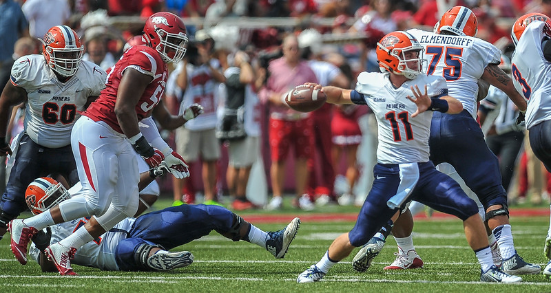 Jeremiah Ledbetter closes on the quarterback during a football game between the Arkansas Razorbacks and the UTEP Miners on Saturday, September 5, 2015 at the  Donald W. Reynolds Razorback Stadium in Fayetteville, Arkansas.  Arkansas won the game 48-13.  (Alan Jamison, Nate Allen Sports Service).