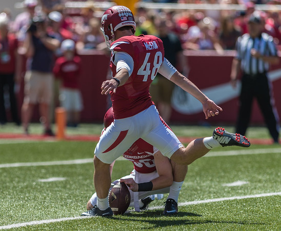 Matt Emrich holds as Adam McFain attempts a field goal during the Arkansas Red-White Spring Football Game on Saturday, April 25, 2015 in Fayetteville, Arkansas at Donald W. Reynolds Razorback Stadium.  The Red team won 62-18 in front of an official attendance of 41,220 fans.   (Alan Jamison, Nate Allen Sports Service)
