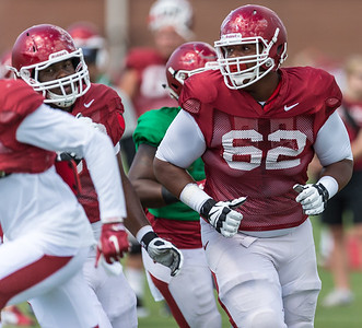 Johnny Gibson (62) drills at the Razorback Football practice on Tuesday, August 11, 2015 at the Fred W. Smith Football Center in Fayetteville, Arkansas.   (Alan Jamison, Nate Allen Sports Service).