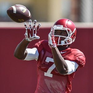 Damon Mitchell with a catch at the Razorback football practice on Thursday, August 20, 2015 at the Fred W. Smith Football Center in Fayetteville, Arkansas.   (Alan Jamison, Nate Allen Sports Service).