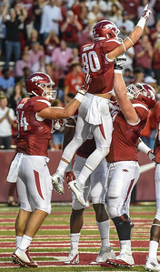 Arkansas wide receiver Drew Morgan (80) celebrates a touchdown with Hunter Henry, Frank Ragnow, and Dominique Reed during a football game between the Arkansas Razorbacks and the Texas Tech Red Raiders at Reynolds Razorback Stadium at the University of Arkansas in Fayetteville, Arkansas.   Texas Tech won 35-24.  (Alan Jamison, Nate Allen Sports Service)
