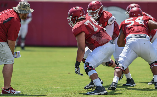 Offensive lineman Colton Jackson (74) at Razorback Football practice on Saturday, August 8, 2015 at the Fred W. Smith Football Center in Fayetteville, Arkansas.   (Alan Jamison, Nate Allen Sports Service).