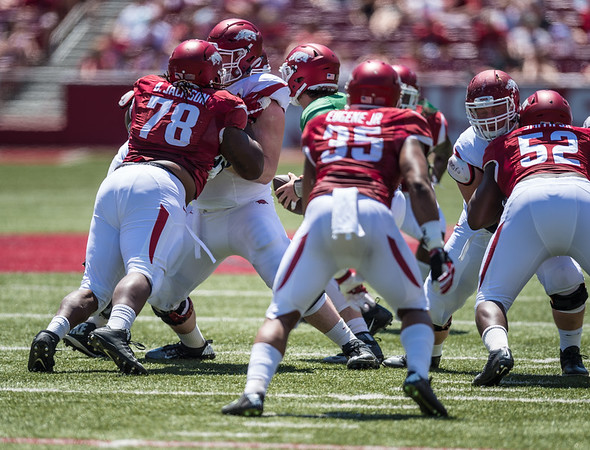 Bijhon Jackson attacks the line during the Arkansas Razorback Spring Football Game on 4/23/2016.   (Alan Jamison, Nate Allen Sports Service)